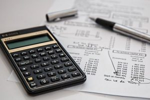 Calculator and financial paper